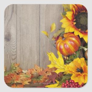 Autumn wreath and leaves on wood background square sticker