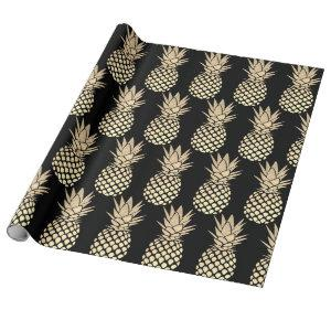 big faux gold foil pineapples on black wrapping paper