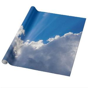 Blue sky with white clouds and ray of sunshine. wrapping paper