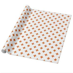 Orange polka crosses on white wrapping paper