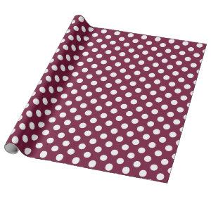 White polka dots on burgundy wrapping paper