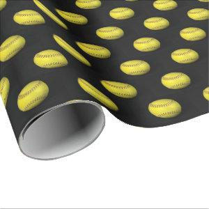 yellow softball on black wrapping paper